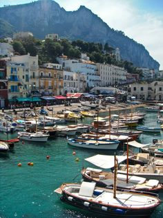Marina Grande - Capri, Italy is a beautiful boat dock off the coast of the boot. Wouldn't it be fun to get in one of those boats and take a spin out into the sea? Count me in!