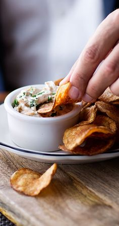 You dip, I dip, we dip. Thick-cut potato chips are served with Chef Michael Shwartz' famous pan-fried onion dip at Michael's Genuine Pub.