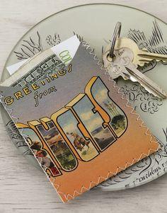 Vintage post cards stitched together to create a slim wallet or business card holder :D