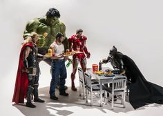 Naturally, Batman is the cool kid that all the others – even Tony Stark/Iron Man – want to sit with in the canteen. | This Photographer Puts Superhero Action Figures Into Awkward Poses