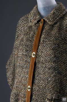 Wool & mohair poncho with tan suede trim and brass toggles ~ Date: Spring 1964