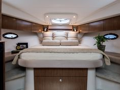 """With a queen-size island berth usually not found in yachts of this category, you'll love access to either side of the bed and an inviting cushioned headboard. Also included is a large hanging locker and numerous cabinets for extra storage. A unique """"tucked away"""" privacy curtain is standard, or select the optional full bulkhead and door."""
