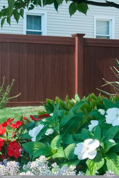Rosewood Wood Grain Illusions PVC Vinyl Privacy Fence Looks Just Like Real Wood Without the Maintenance. Vinyl Fence Panels, Vinyl Privacy Fence, Diy Fence, Backyard Fences, Pool Fence, Fence Ideas, Wood Vinyl, Pvc Vinyl, Vegetable Garden Tips