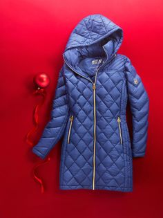 MICHAEL Michael Kors' down puffer coat will keep her warm in style. She'll love the chic details like metallic zippers and cool quilting.