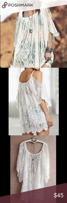 FREE PEOPLE White Lace Cold Shoulder Cover Up Top This is a Free People white lace cover up. Can be worn as a top with jeans and a tank, or a dress with a slip as well. Size Medium but could fit a size down or up. Retails for $98. Mint condition and never worn. No trades please  Free People Tops Tunics