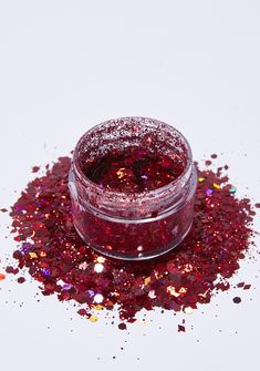 The Gypsy Shrine Red Diamond Face Glitter cuz you make it hot. This holographic red glitter is safe for your face, body, N' hair and has different sized pieces to give you a dynamic look. #Chrome #Holographic #Alien #Unicorn #Glitter #Metallic #Silver #Sequin #VeganLeather #Clear #Seethrough #Reflective #Galaxy #Space #Stars #Planets #Astro