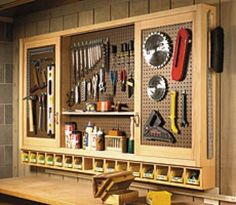 Garage sliding door pegboard cabinet building plans - this could be super useful in a craft room too (paint it white or a pretty color and store craft supplies, etc). might have to coerce dad into building this for me! Workshop Storage, Tool Storage, Garage Storage, Storage Ideas, Diy Storage, Pegboard Storage, Workshop Ideas, Workshop Plans, Bench Storage