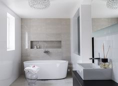 Streamlined modern beige and white bathroom with a relaxing spa feel.