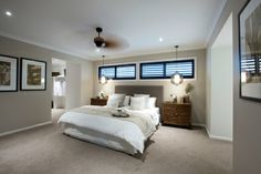 This Balinese style master bedroom is rich in natural wooden elements as timber creates the base palette. Hanging pendant lights and layering white linen create a relaxing oasis. As displayed in Brookwater 49 at Saltwater Coast Estate.