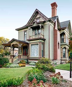 A formerly tired 1886 house reclaims its proud Painted Lady heritage with a distinctive palette that draws out its distinctive details. Shown here: Sherwin-Williams's Garden Sage for the base color, accented with darker-green Meadow Trail, cinnamony Tanbark, and golden White Raisin. The front door and some smaller details are Carriage Door.   Photo: Jason Dailey   thisoldhouse.com