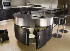 Unique shape for a #modern #kitchen island shared by @Salon Blue Ridge