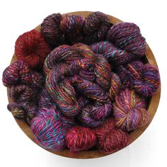 A bowl of purple yarns.
