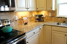 Santa Cecilia Countertop with  Butterscotch Cabinets and Ceramic Square and Ceramic Mosaic Tiles