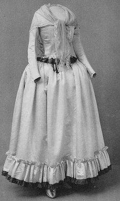 White atlas silk dress worn by Maria Chatarina Röhl, née Brandelius, the day after her wedding. Trimmed with green ribbons.