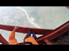 "Matthias Giraud aka ""Super Frenchie"" goes BASE jumping with thirty-three base jumpers from 15 countries gathered in China's Guizhou Province to tackle Gopro Hd, Third Base, Base Jumping, Skydiving, Bridge, Earth, China, Bridge Pattern, Legs"