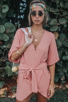 Our newest arrivals live now! Shop this pink wrap up romper for those warm summer days!
