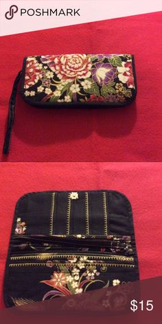 Floral wristlet - brand new, never used Beautiful purple and red flowers on a black background. 4 spots for credit cards, 1 zipper pouch on the inside and outside, and 2 other nice storage areas for cash or your phone. Bags Clutches & Wristlets