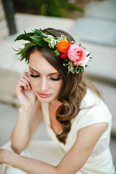 bride's bold flower crown hair flowers for wedding reception featuring coral pink garden rose, orange and red ranunculus
