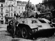 Two german soldiers next to the Soviet tank T-34 abandoned in Lviv, Ukraine.