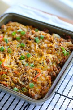 Sassy Sausage & Hash Brown Casserole: INGREDIENTS 4 cups frozen shredded hash brown potatoes 16 ounces hot sausage 1/4 cup finely chopped onion 1/4 cup finely chopped bell peppers, green and red 1/2 clove minced garlic minced jalapeno to taste (I used about 1/2 teaspoon) 1 cup shredded, sharp cheddar cheese 1 (12-ounce) can evaporated milk 1 egg, lightly beaten 1/2 teaspoon cayenne pepper 1-2 tablespoons olive oil dash paprika salt and pepper to taste
