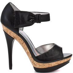 You wont be able to part ways from this fixating sandal from Paris Hilton. Flora has a black man made upper with an adjustable ankle strap and single strap at the vamp.  A 5 inch black heel and a 1 inch platform is trimmed with cork to create that must have look.