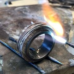 Creating a timber and canvas ring in 18ct white Gold.  You can see a few of the steps involved in making up this ring, hammering, heating, rolling, filing, sawing and polishing.  These rings are all made to order in a combination of materials and colours of your choosing.  Thanks for watching…