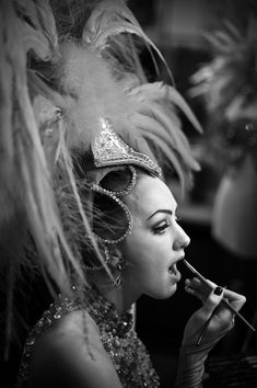 Moulin Rouge. Vintage showgirl. Note the eye makeup and the classic pattern of pale lid and dark socket line. - #Cabaret