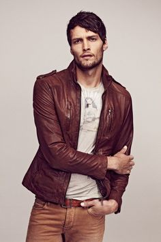Brown leather bomber jacket with brown jeans
