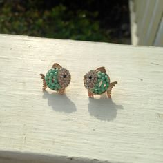 Turquoise and gold fish earrings with rhinestone accents on Etsy, $12.00