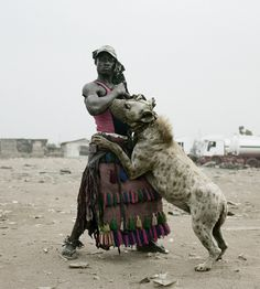 Pieter Hugo shot the series 'The Hyena & Other Men' in Nigeria. Pieter was captivated by the first pictures of the 'hyena men' that he came across randomly. He went to live with them on the periphery of Abuja in a shantytown - a group of men, a little Badass Pictures, Cool Photos, Random Pictures, Hyena Man, Photographie Street Art, Animals And Pets, Cute Animals, Exotic Animals, Wild Animals