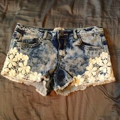 Cute denim shorts 💥Price Firm💥Denim shorts size 9 in juniors. Has a tye dye blue denim look and thick white flower lace design in the sides. These shorts are gorgeous and very flattering! They are too big on me now and I hate to see them go. Only worn a few times and are like new 😍 Jeans