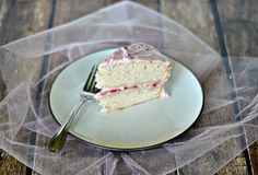 Strawberry Dream Cake is a lightly flavored strawberry cake filled with fresh strawberries and topped with fluffy strawberry frosting. | Hezzi-D's Books and Cooks
