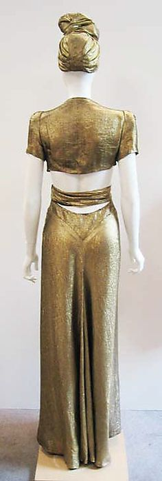Back view - Gold lamé ensemble (evening gown and matching turban) by Jay-Thorpe, Inc., American, ca. 1945.