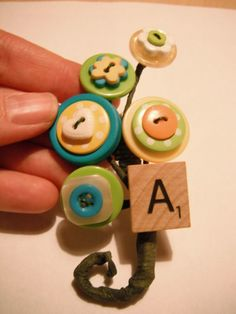 A Button Bout :  wedding bouquet bout boutonniere button diy flowers green yellow Try3