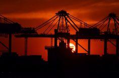 #backlit #built #cargo #concrete #construction #container #container port #export #freight #harbor #harbour #harbour cranes #heavy equipment #industry #loading #maritime #port #port facility #silhouette #steel #
