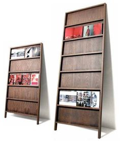 Leaning shelf to display books, journals, magazines, maps, pamphlets, etc.