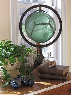 Antique globe stand with Old glass fishing float added