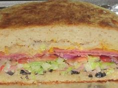Schlotzsky's Original Sandwich Copycat - Schlotzsky's is a chain based sandwich shop which originated in Austin, TX. The Original sandwich consists of a sourdough bun, with deli meats, cheeses and marinated black olives. The taste of this sandwich is very unique and I am very pleased that this copycat recipe nailed it.