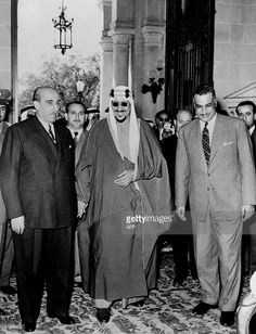 1956: Saudi Arabia King Saud ibn Abd al-Aziz (1902 - 1969) (C) surrounded on his left by Egyptian president Gamal Abdul Nasser (1918 - 1970) and on his right by Syrian president Shukri al-Kuwatli (1891 - 1967), arrives in March 1956 at Kubbeh Palace in Cairo for Syria-Saudi Arabia and Egypt meeting.