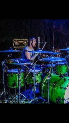 Great neon green and vivid royal blue lighting / drumkit shells.
