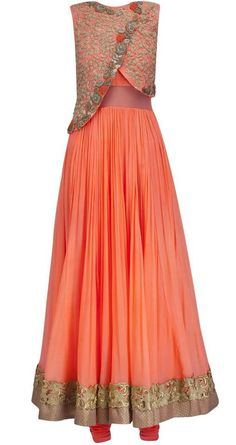 Orange gown with an asymmetrical cross body blouse front. floral pattern and embroidery on peach and gold blouse