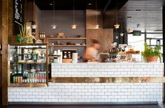 white tiles with gold accents, subway tiles, espresso, counter restaurant design Design Café, Deco Design, Cafe Design, Cafe Restaurant, Restaurant Design, Restaurant Counter, Modern Restaurant, Café Bar, Decoration Restaurant