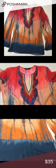 BCBG Chiffon embroidered embellished Tunic SO FUN AND SEXY. Rainbow tie dye printed delicate chiffon with intricate embroidery, sequins, and beads around the collar. Can be worn over a cami but BEGS to be worn over a sexy black bra. Its in great condition and only worn a few times but I did notice a small stain at the bottom... its barely noticeable on its own and impossible to see when worn because the blue blends in with jeans, dark pants etc.... shown in last pic BCBGMaxAzria Tops Blouses