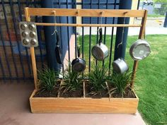 Garden at the bottom with music at the top. Excellent upcycling idea for the home corner clothes hanger.