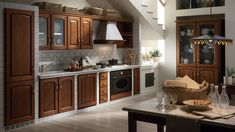 """The Futuro Futuro """"Classic Collection"""" range hoods showcase the best of Italian kitchen range hood design, adapted for the classic / country / rustic style kitchen. Kitchen Fan, Kitchen Hoods, Kitchen Dining, Kitchen Decor, Kitchen Cabinets, Hardwood Floors In Kitchen, Wood Trim, Traditional Kitchen, Kitchen Styling"""