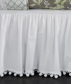 A touch of ball fringe in an unexpected place makes us smile. (Country Curtains Ball Fringe Bed Skirt)