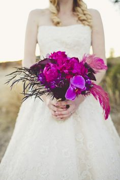 I like how the feathers and feathery leaves soften the bouquet, the leaves could be used more profusely...