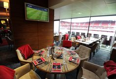 Looking around Arsenal's Emirates Stadium. Directors Box before a game.