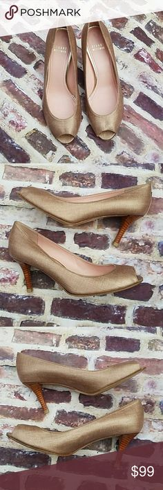 Stuart Weitzman ROSE GOLD peep toe heels These are gorgeous rose gold peep toe heels from Stuart Weitzman. They have gorgeous wooden heels that are in great condition gold detail on the back. They're either a coated canvas or linen that has a nice sheen to it the soles are in great condition was little wear. The only blemish that I see are two bumps on the inner lower part of the fabric that are not noticeable when on. Stuart Weitzman Shoes Heels