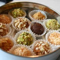Coconut Milk Brigadeiros... delicious Brazilian confections rolled in crushed nuts, toasted coconut flakes & chocolate.